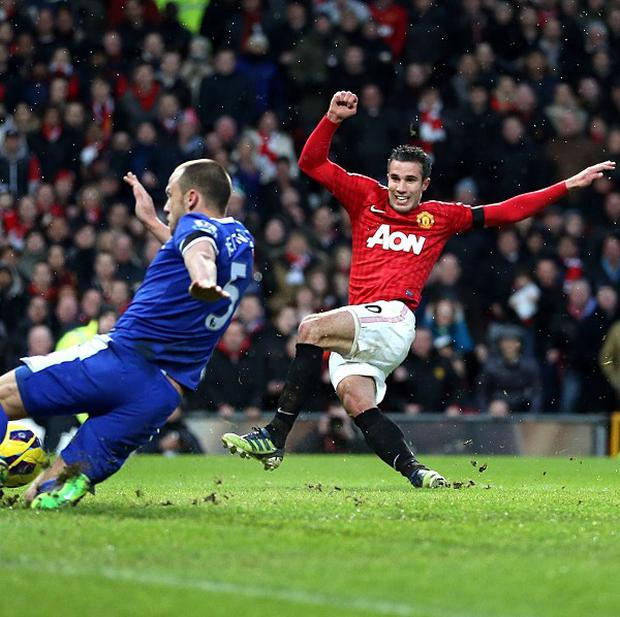 Robin van Persie, right, scores Manchester United's second goal of the game against Everton
