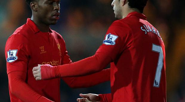 Daniel Sturridge, left, is enjoying playing with Luis Suarez