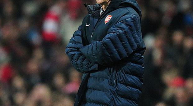 Thomas Vermaelen believes Arsene Wenger, pictured, 'is the right man for' Arsenal