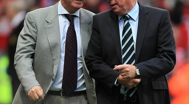 Sir Alex Ferguson, left, feels Harry Redknapp, right, can help QPR survive