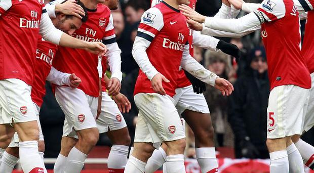 Santi Cazorla netted a brace as Arsenal claimed three points from their clash with Aston Villa