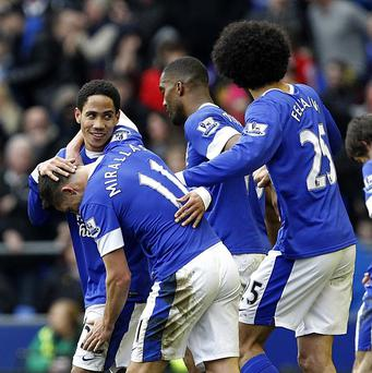 Marouane Fellaini, right, Steven Pienaar, left, and Kevin Mirallas, second left, netted a goal apiece in Everton's victory over Reading