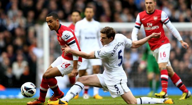 LONDON, ENGLAND - MARCH 03: Theo Walcott of Arsenal is tackled by Jan Vertonghen of Spurs during the Barclays Premier League match between Tottenham Hotspur and Arsenal FC at White Hart Lane on March 3, 2013 in London, England. (Photo by Paul Gilham/Getty Images)
