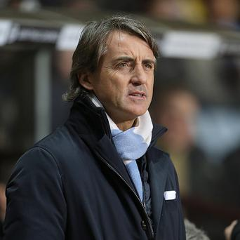 Roberto Mancini admits his side may have to go undefeated to retain their title
