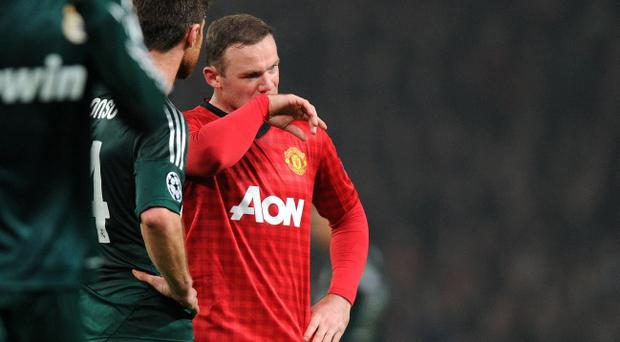 Manchester United's Wayne Rooney shows his dejection after a missed chance against Real Madrid during the UEFA Champions League match at Old Trafford