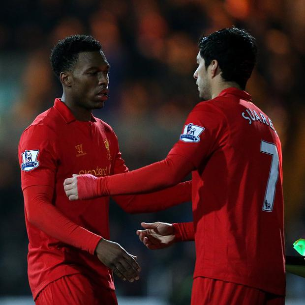 Daniel Sturridge, left, and Luis Suarez, right, have scored seven times in six appearances together