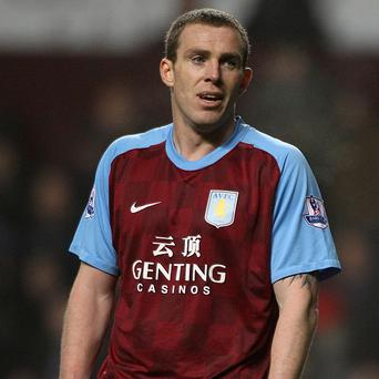 Richard Dunne's, pictured, long-term groin problem is not career-threatening, according to Paul Lambert