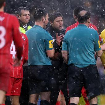 Southampton manager Mauricio Pochettino, centre, approached match officials and referee Mike Clattenburg on Saturday