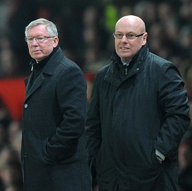 Sir Alex Ferguson, left, believes Brian McDermott did a great job at Reading