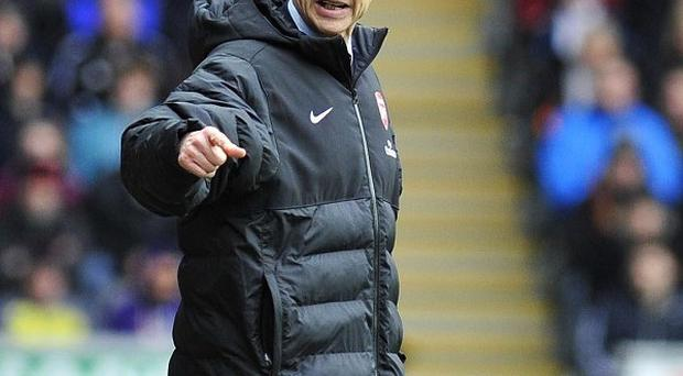 Arsene Wenger's Arsenal became the third side to win at the Liberty Stadium this season
