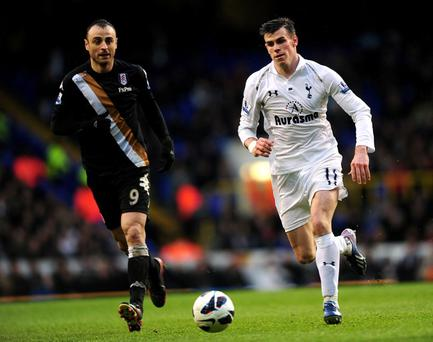 Fulham's Dimitar Berbatov (left) and Tottenham Hotspur's Gareth Bale in action during the Barclays Premier League match at White Hart Lane, London
