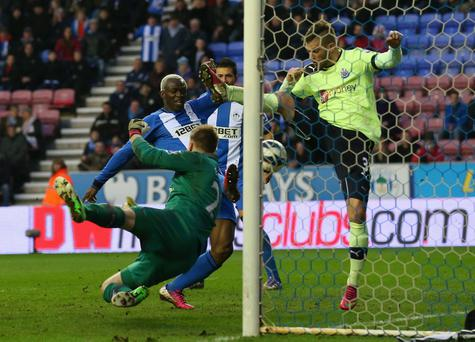 WIGAN, ENGLAND - MARCH 17: Arouna Kone of Wigan Athletic scores the winning goal during the Barclays Premier League match between Wigan Athletic and Newcastle United at the DW Stadium on March 17, 2013 in Wigan, England. (Photo by Alex Livesey/Getty Images)