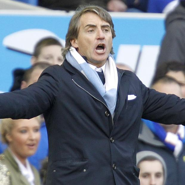 Roberto Mancini, pictured, is unhappy with Vincent Kompany's appearance for Belgium