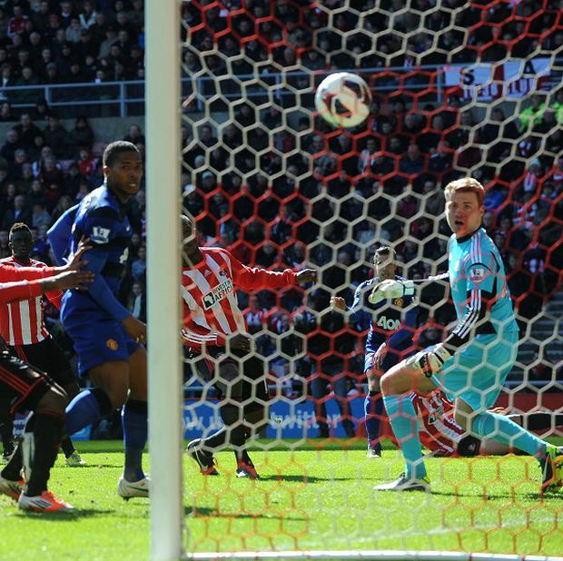Robin van Persie's, second right, shot was deflected into the goal by Titus Bramble, centre