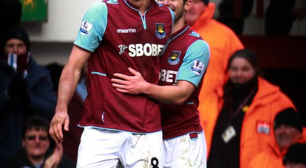 Andy Carroll, left, was in great form on Saturday