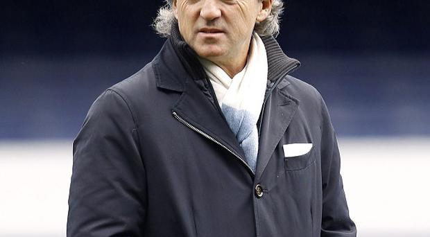 Roberto Mancini , pictured, was please with captain Vincent Kompany's comeback