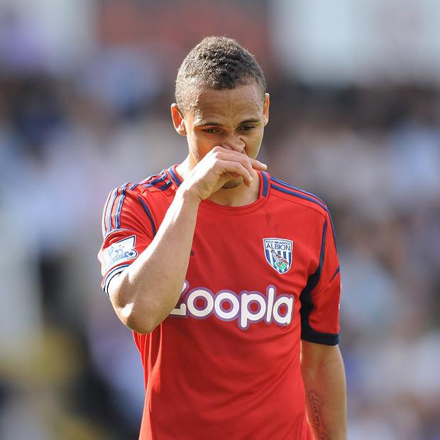 West Brom's Peter Odemwingie has been urged to calm down