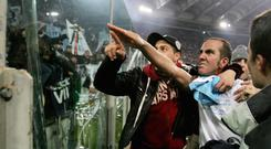 Picture taken 06 January 2005 of Paolo Di Canio while playing for Lazio, gesturing towards the club's fans at the end of Lazio vs AS Roma Serie A football match at Rome's Olympic stadium