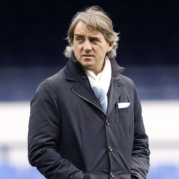 Roberto Mancini is aiming to reduce Manchester United's lead at the top