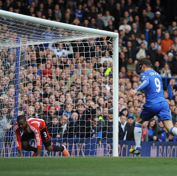Danny Rose, left, cannot prevent Chelsea from netting their winner