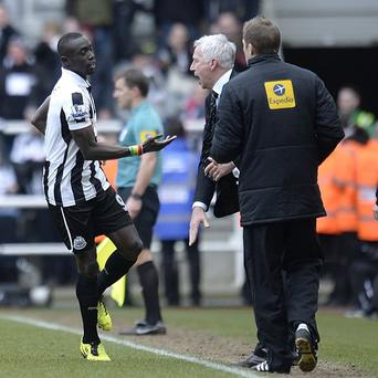 Papiss Cisse, left, celebrates his late winner with Newcastle boss Alan Pardew, right