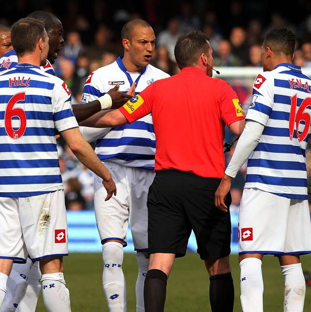 Bobby Zamora, centre, was sent off for QPR