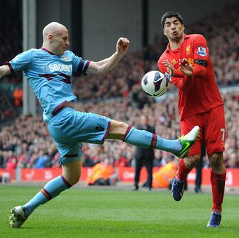 James Collins, left, marked Luis Suarez, right, out of the game at Anfield
