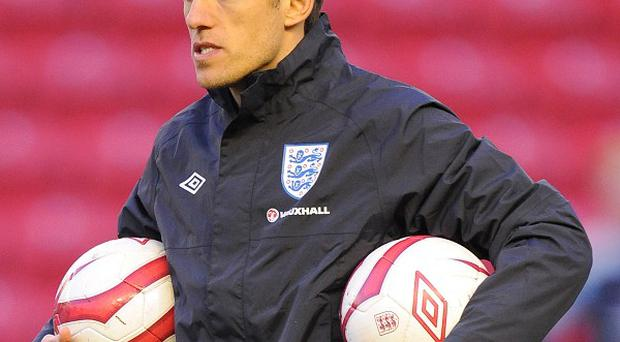 Phil Neville will work as part of England Under-21s backroom staff at the European Championship