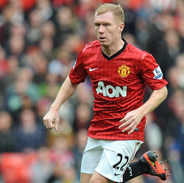 Bryan Robson believes Paul Scholes, pictured, may retire for good this summer