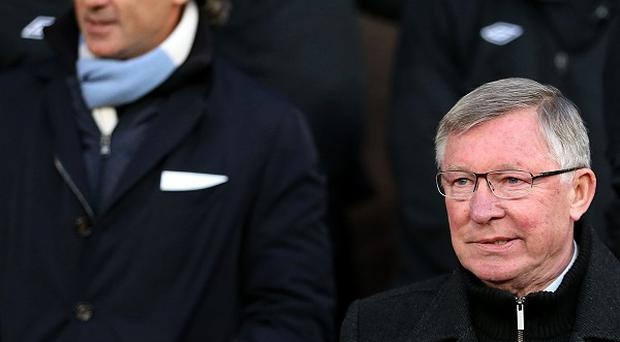 Sir Alex Ferguson, bottom right, hit back at Roberto Mancini's, top left, claims Manchester United have it easy