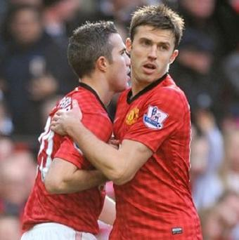 Robin van Persie, left, and Michael Carrick are on the shortlist for the PFA's Player of the Year award