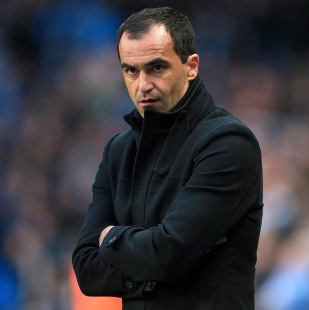 Roberto Martinez, pictured, has highlighted Andy Carroll's danger ahead of the weekend