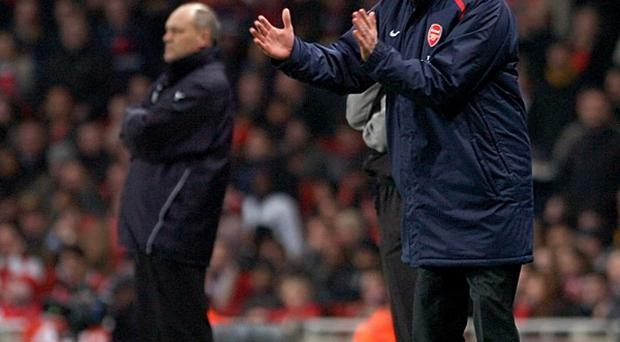 Martion Jol, left, thinks Arsene Wenger is 'an unbelievable manager'