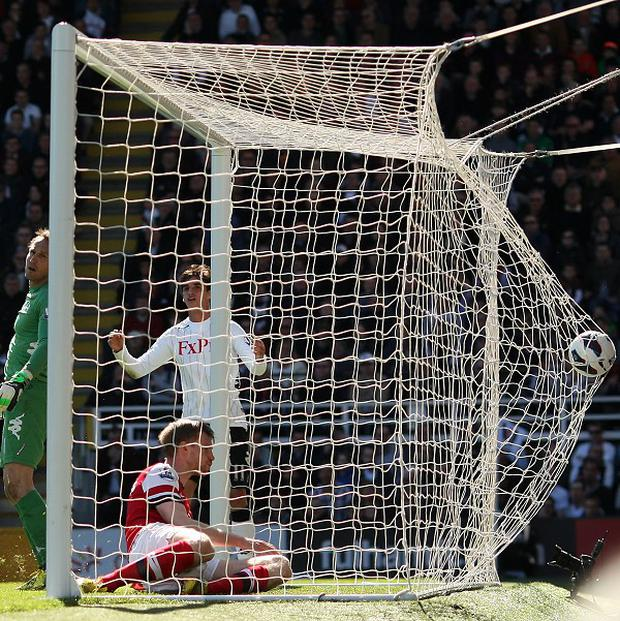 Per Mertesacker, bottom, scored the opening goal of the game just before the break for Arsenal