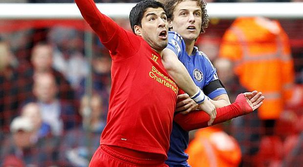 Luis Suarez, left, who bit Branislav Ivanovic, netted a last-minute equaliser for Liverpool