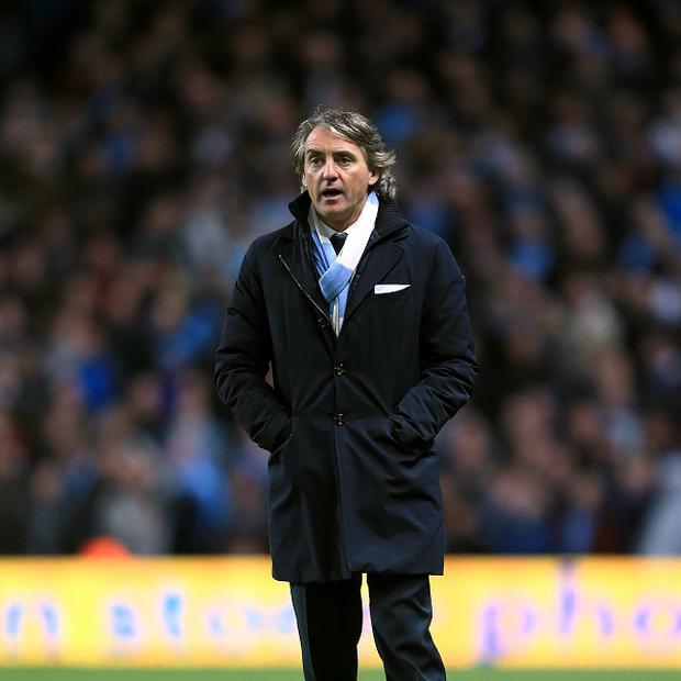 Roberto Mancini feels Manchester City are as good as United