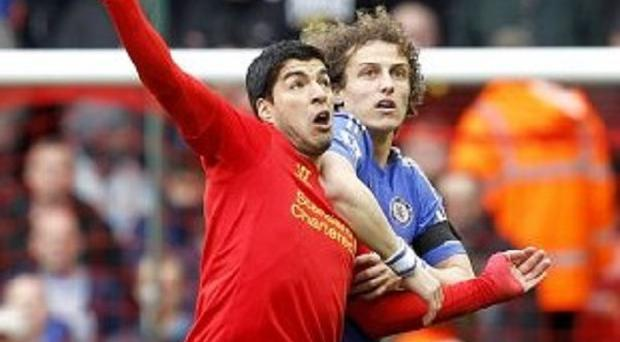 Luis Suarez, left, will not face police punishment after biting Branislav Ivanovic