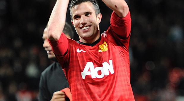 Robin van Persie celebrates after winning his first Barclays Premier League title