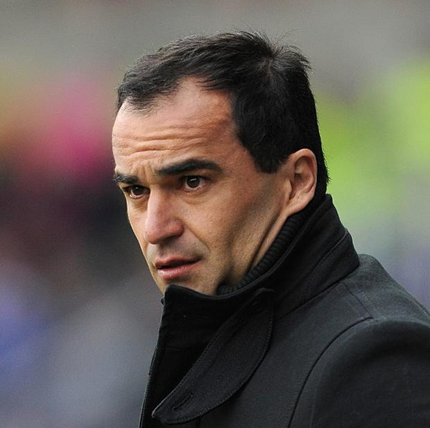 Roberto Martinez, pictured, believes Luis Suarez deserves a lengthy suspension