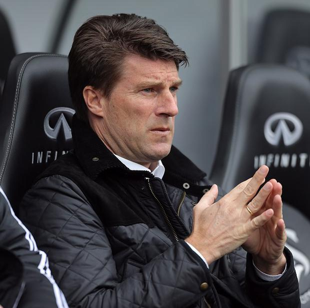 Michael Laudrup is expecting Chelsea to provide a stern test for Swansea