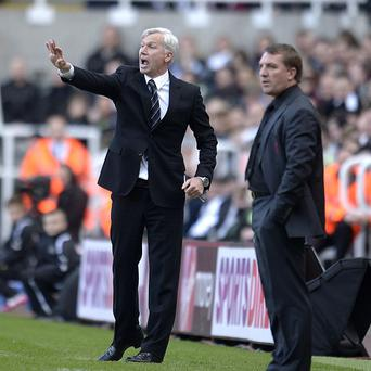 Alan Pardew, left, saw his side slip to their heaviest home defeat since 1925