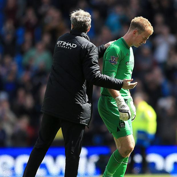 Joe Hart, right, suffered a back spasm against West Ham