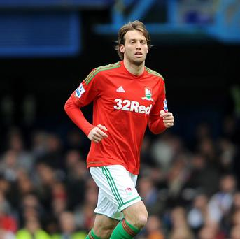 Michu was withdrawn during the second half against Manchester City with a hamstring problem