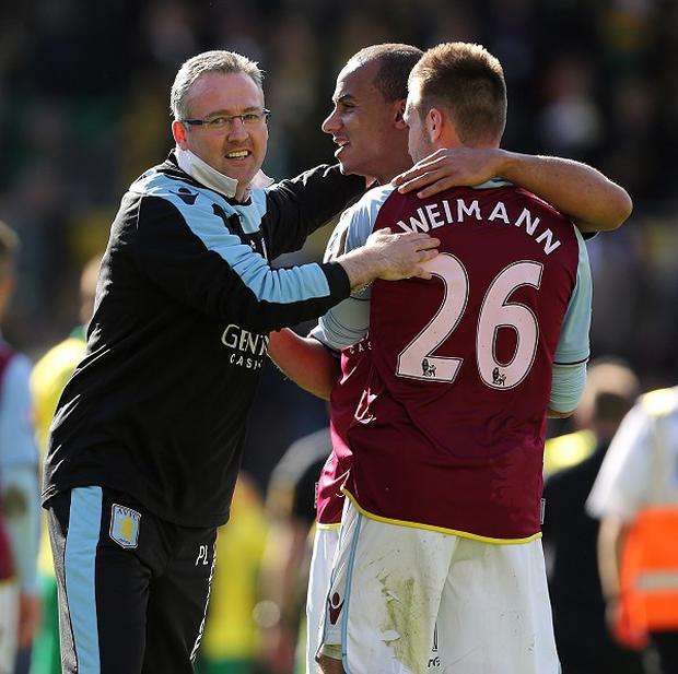 Paul Lambert, left, guided his Aston Villa side to the 40-point mark