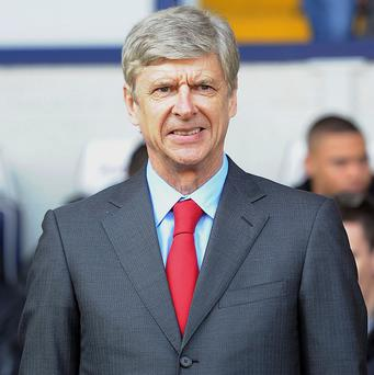 Arsene Wenger is enjoying the challenge of guiding Arsenal into the top four