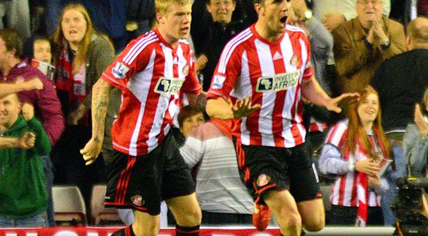 John O'Shea, right, scored a second-half equaliser to claim a much-needed point for Sunderland