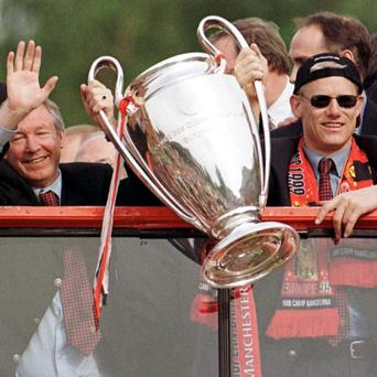Peter Schmeichel, right, was 'disappointed and very sad' after hearing of Sir Alex Ferguson's decision to retire