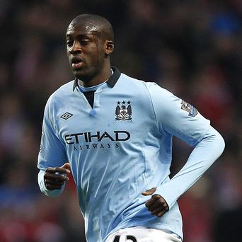 Yaya Toure, pictured, is hoping Manchester City can take advantage of Manchester United losing Sir Alex Ferguson