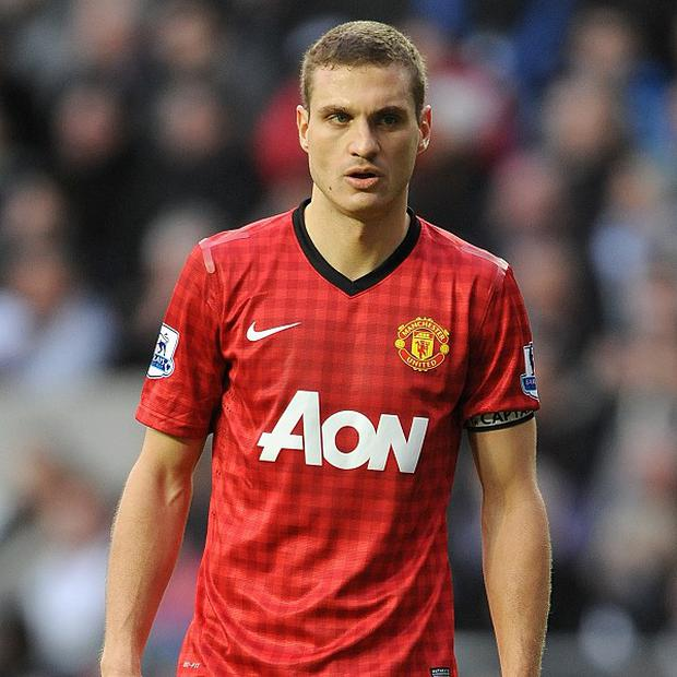 Nemanja Vidic, pictured, is looking forward to working with David Moyes