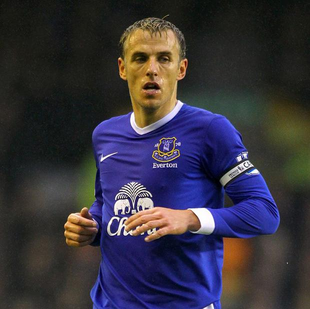 Phil Neville, pictured, is looking forward to celebrating David Moyes' achievements for Everton on Sunday